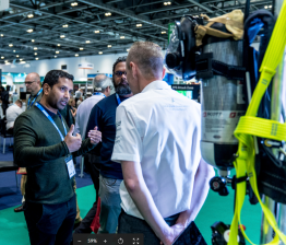 Visitors discussing PPE at Safety & Health Expo 2019